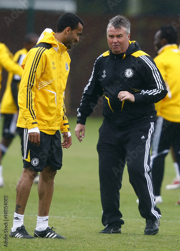 Chelsea Manager Guus Hiddink Talks To Jose Boswinga During A Team Training Session In Cobham