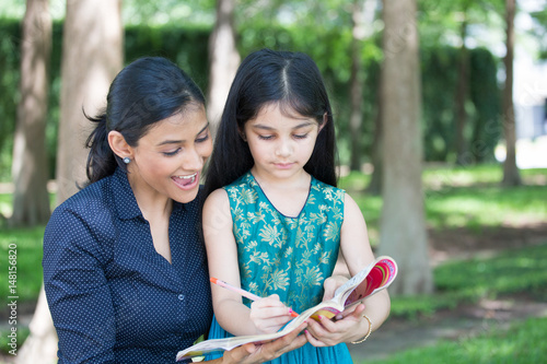 Fotografie, Obraz  Closeup portrait, young family enjoying coloring book, drawing, isolated outdoor