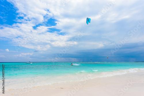 Kite surfing at paradise beach