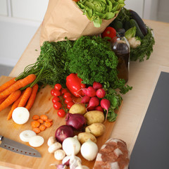 Grocery shopping bag with vegetables on kitchen