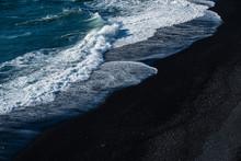 Black Sand Beach With Wave