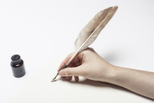 Woman Hand Hold A Fountain Pen...