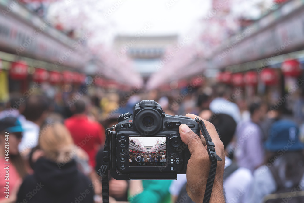 Fototapety, obrazy: Camera capturing Senso-ji temple walking street (Nakamise) with many tourists in background.