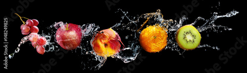 Tuinposter Vruchten Set of fresh fruits in water splash isolated on black background