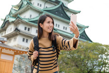 Woman Taking Photo With Nagoya...