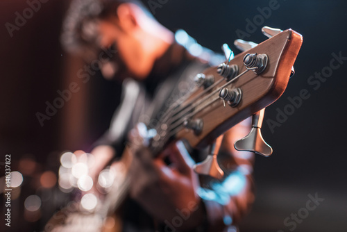 Fotomural  Electric guitar player playing hard rock music with bass guitar on stage