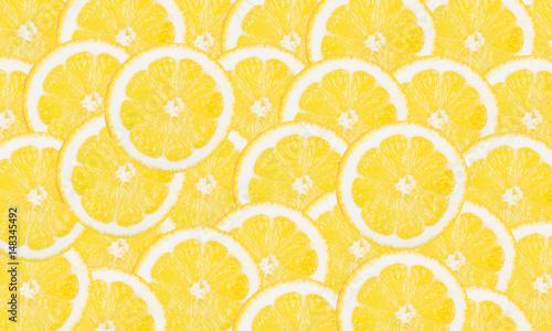 Lemon slices vibrant background.