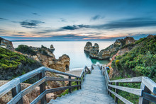 Wooden Footbridge Walkway To Beautiful Beach Praia Do Camilo On Coast Of Algarve Region, Portugal