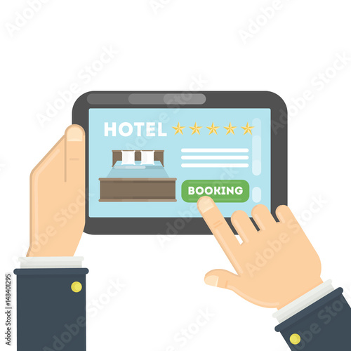 Online hotel booking. Hands holding tablet to book a room in the hotel.