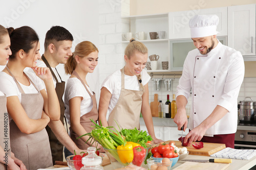 Poster Cuisine Male chef and group of people at cooking classes