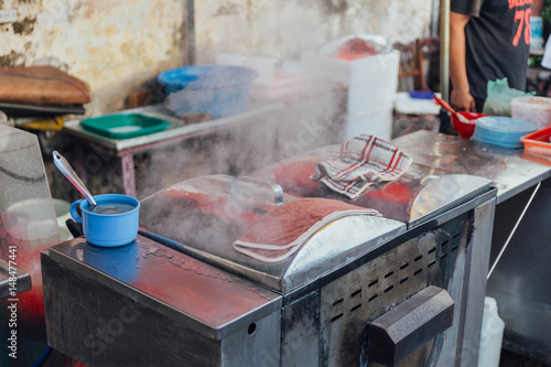 Steaming on aluminium stove in morning market at George Town