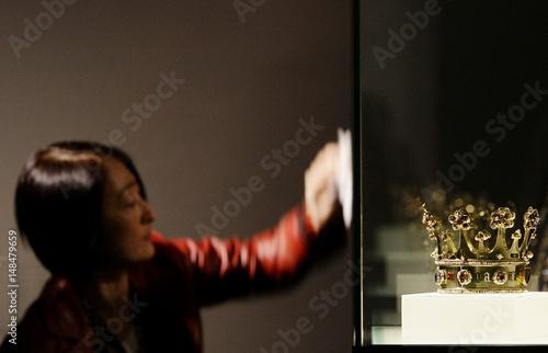 Worker cleans display case of crown of Margaret of York