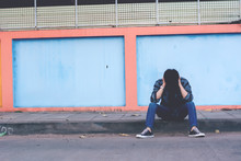 Lonely Man Sitting On The Street
