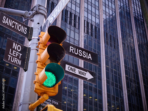 Photo NYC Wall street yellow traffic light black pointer guide one way green light to Russia, no turn no way to Sanctions