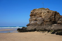 Rocky Outcrop On A Sandy Beach...