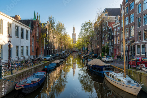 Photo  Houses and Boats on Amsterdam Canal, Netherlands