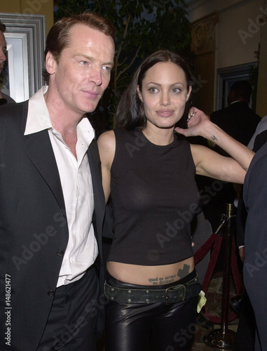 ANGELINA JOLIE POSES WITH IAIN GLEN AT LARA CROFT - TOMB RAIDER
