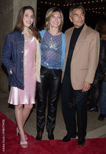 OLIVIA NEWTON JOHN ARRIVES WITH DAUGHTER CHLOE AND PATRICK