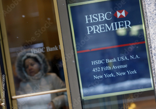 A customer exits the HSBC bank branch located at the HSBC North