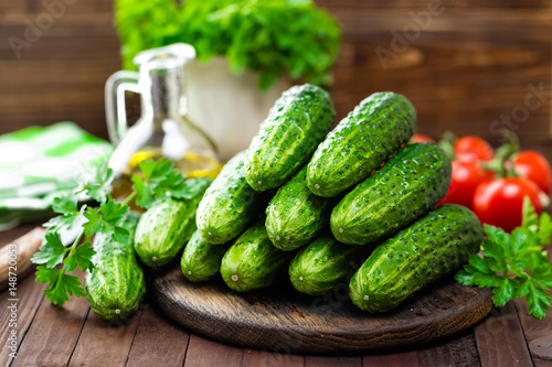 Fresh cucumbers on wooden table