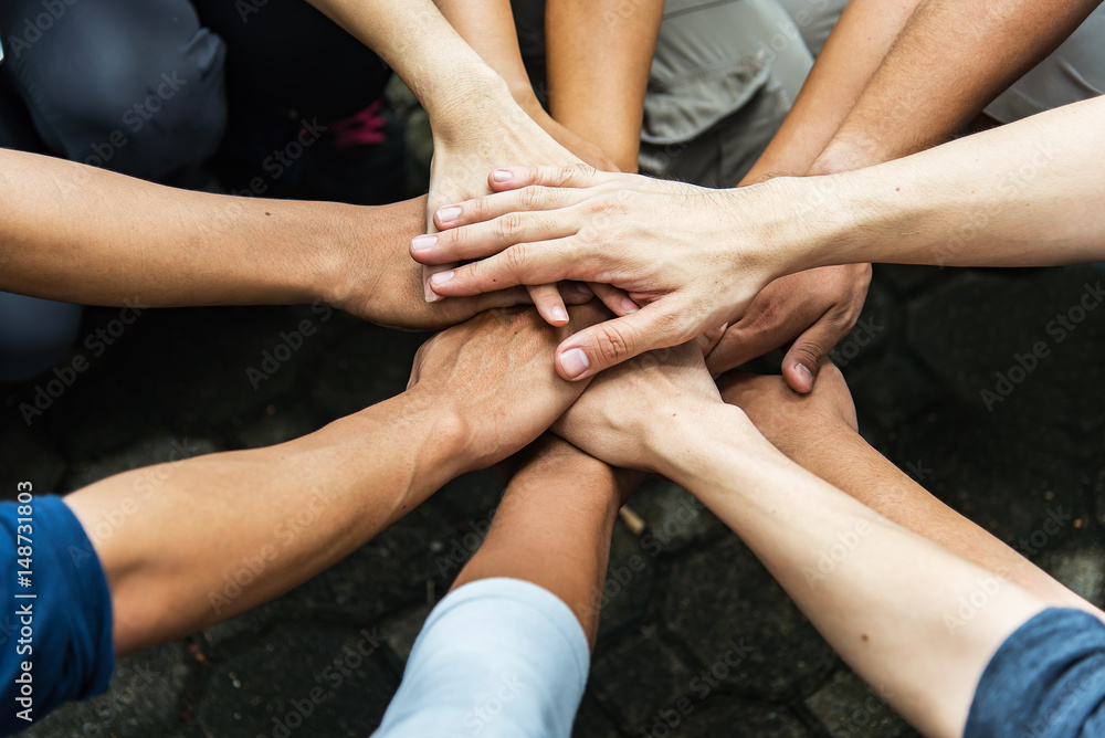 Fototapeta Group of people United Hands to built teamwork together with Spirit - teamwork concepts.