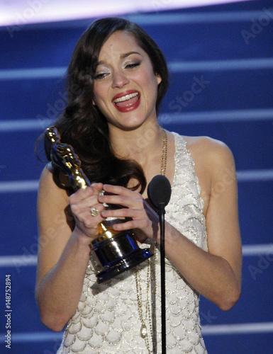 Actress Marion Cotillard Accepts The Oscar For Best Actress