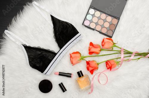 6d12e42dc Black lace bra on the white fur. Orange roses