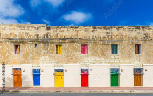 Marsaxlokk, Malta - Traditional maltese vintage house with orange, blue, yellow, Wallpaper Mural