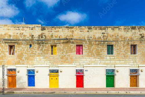 Photo  Marsaxlokk, Malta - Traditional maltese vintage house with orange, blue, yellow,