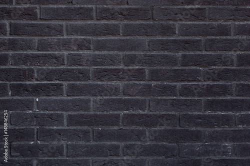 Close-up of anthracite-black brick wall texture. Canvas Print