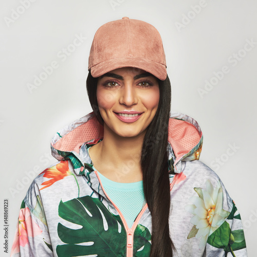 Fotografie, Obraz  Pretty young woman in a peaked cap