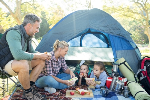 Poster Camping Family having snacks outside the tent