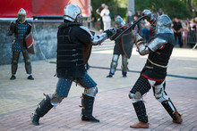 Two Knights Are Fighting At A Performance In The City