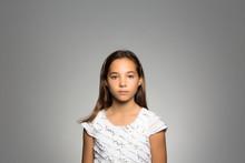 Studio Portrait Of A Pensive Girl