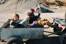 Children And Dog Riding In Dune Buggy Cart