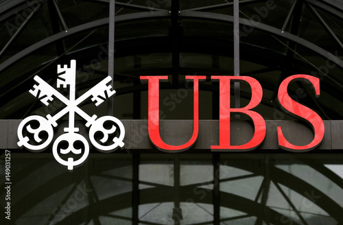 A UBS logo is seen outside a building in central London