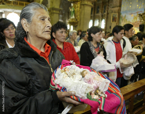 Bolivian women hold their Jesus Christ statues during a traditional