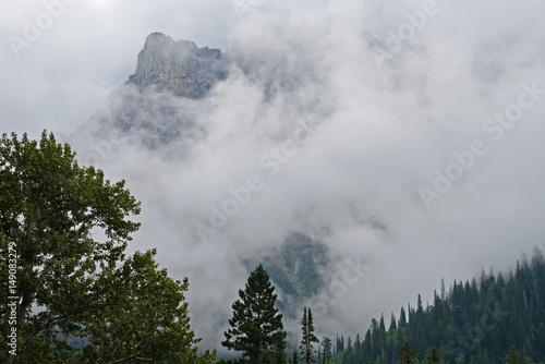 Fotografia, Obraz  Fog covers the mountains of Glacier National Park.
