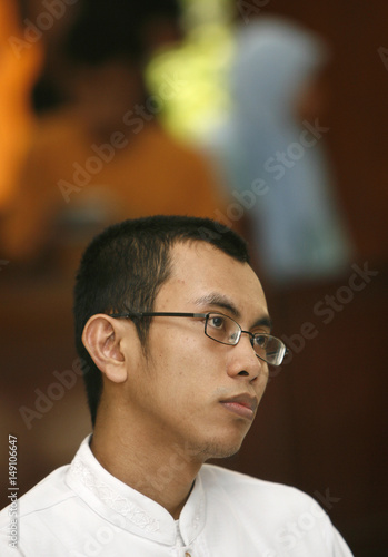 An Indonesian Islamic Militant Abdul Muis Listens To The Judges During His Trial In South Jakarta