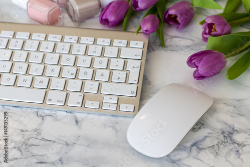 Deurstickers Frangipani Woman office desk with Spring blossom flowers, tulips on white background top view mockup