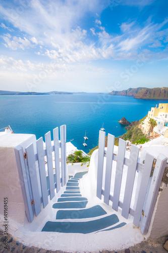 Fototapeta A traditional symmetric door yard, Ia, Santorini, Greece. Honeymoon summer aegean cycladic background, serenity, tranquility. obraz