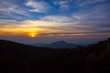 Beautiful Colorful Sunrise and Silhouette Mountain on the top of mountain in Thailand