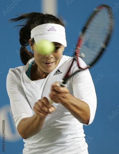 Ana Ivanovic returns the ball to Peng Shuai at the JB Group Classic 2008  tennis tournament 72dc0c41d