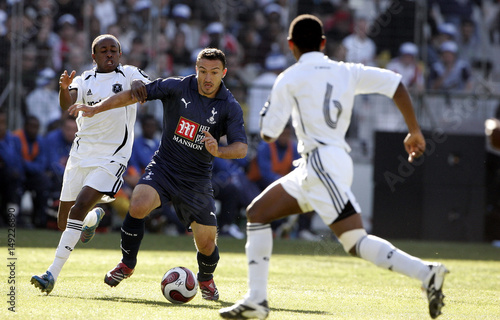 Tottenham Hotspur's Steed Malbranque is challenged by South Africa's