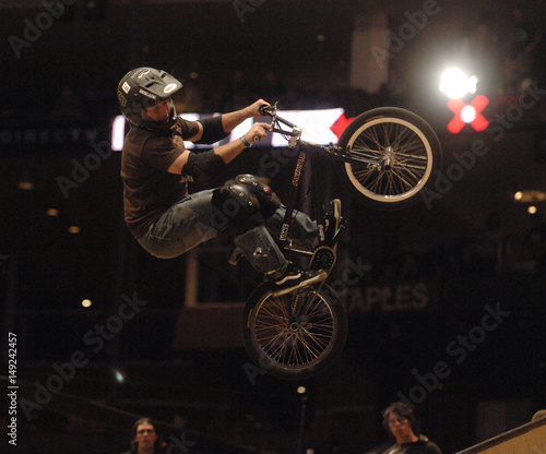 Dennis McCoy competes in the BMX Freestyle Vert competition during