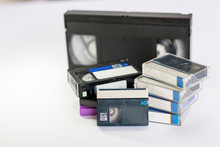 Mini Dv And  VHS Video Tape Isolated On White