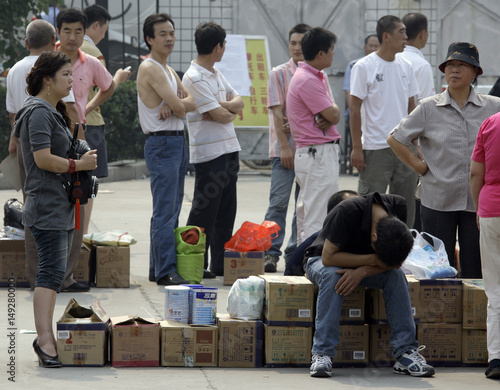 Local residents stand in lines at headquarters of Sanlu