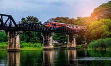 The Train Is Running On The World War II Bridge In Kanchanaburi.