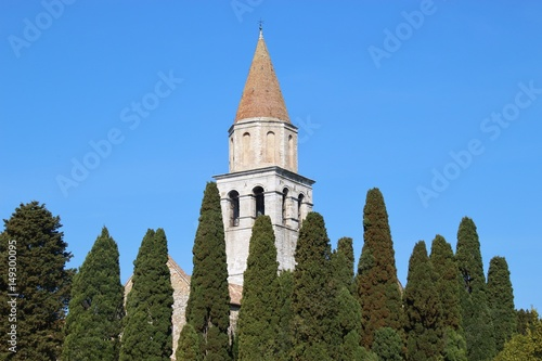 The bell tower of the patriarchal Basilica Santa Maria Assunta of Aquileia, an ancient Roman city in North Italy Wallpaper Mural