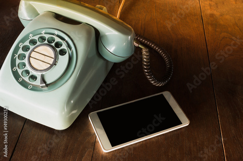 Two phone different technology  Modern mobile phone and old vintage